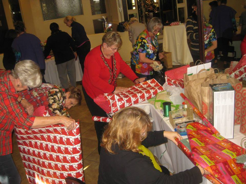 Soroptimists wrapping Christmas gifts for the families at Su Casa